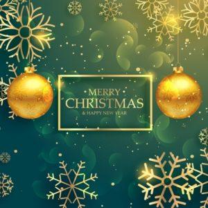 黄金の雪片と緑のクリスマスの背景