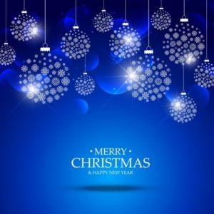 雪で作られたクリスマスボール青の背景